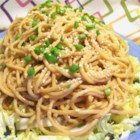 My Favorite Sesame Noodles - Spaghetti noodles are tossed with peanut butter, tamari, and Thai chili sauce for this quick, Asian-inspired meal for one.