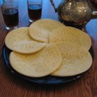 Beghrir (Moroccan Pancakes) - Semolina gives these exotic yeast pancakes a light, lacy texture, and the thousands of tiny holes catch the sweet honey and butter sauce with optional orange blossom. Substitute rosewater flavor if you prefer.
