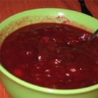 "Oranged Cranberry Sauce - This recipe was graciously shared with me by a Jamaican friend, many years ago. It makes a delicious sauce, different from any other cranberry sauce I've ever tasted or made.  It does not ""gel"" but you do want to cook it long enough to make a good, thick consistency. You can use 1 tablespoon of excellent quality ground cinnamon instead of the cinnamon stick, if you prefer.  Originally submitted to ThanksgivingRecipe.com."