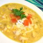 Mexican Chicken Corn Chowder - This creamy chicken and corn chowder, made spicy with ground cumin, green chilies, and hot pepper sauce, will warm you right through.  Shredded Monterey jack cheese and half and half make this soup rich and delicious.
