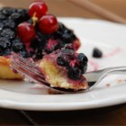 Fresh Blueberry Pie III - The pie crust for this very blueberry pie is made with sugar and milk, and it bakes up perfectly to accommodate the two cups of fresh blueberries and the two cups of cooked ones that are layered into the pie shell. This pie makes a sweet treat that is chilled in the fridge and served with whipped cream.