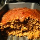 Kitchen Sink Meatloaf - A slightly sweet, melt-in-your-mouth meatloaf with a variety of always-on-hand ingredients. It's super easy to make and a real crowd-pleaser. This recipe is always requested at family functions and parties.