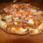 Satay Chicken Pizza - Chicken with Thai peanut sauce is topped with provolone cheese on fun individual pizzas with pita bread crusts.