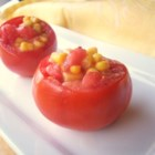 Corn-Stuffed Tomatoes - As a vegetarian I keep my eyes open for different recipes that are easy to make. I've had this one for years. Tomatoes are stuffed with a buttery corn mixture and baked. Perfect for summer and they make a brightly colored addition to any meal.