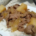 Nikujaga (Japanese-style meat and potatoes) - This main dish recipe features sliced beef sirloin cooked with potatoes, and onion in a sauce made with prepared dashi soup, sake, and soy sauce.