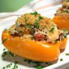 N'Awlins Stuffed Bell Peppers - Momma's Peppers...Whenever my mother prepares this Stuffed Bell Pepper dish, everyone in the family finds an excuse to 'drop by' for a visit to my parents' home. Being a fourth generation native New Orleanian, my mother offers a plate of food to anyone who stops by for a visit...that's why this recipe makes twelve servings!