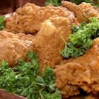 "A Southern Fried Chicken - ""A cut-up chicken dredged in buttermilk and seasoned flour, then deep-fried to perfection."""