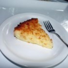 Impossible Coconut Pie I - We like this pie because the filling makes its own crust. All the ingredients are mixed in an electric blender, poured into a pie plate, sprinkled with coconut, and baked up into a rich custardy pie.