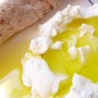 Labneh (Lebanese Cream Cheese) - This is the Lebanese version of cream cheese, a lot tastier and lower in calories. Serve on a plate, sprinkled with olive oil, olives, tomatoes, cucumbers and mint. Or simply spread it like cream cheese on pita bread.