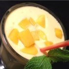 Mango Lassi-Come-Home - Pureed mango and mango nectar are blended with lemon yogurt, vanilla yogurt, milk, and honey to make a delicious beverage suitable for serving with your favorite curry dish.