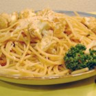 Pasta and Cauliflower - Tasty florets of steamed cauliflower are combined with sauteed onion and garlic and a handful of parsley, then tossed with hot spaghetti and topped with grated Parmesan for a quick, satisfying meal.