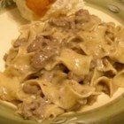 Simple Beef Stroganoff - Browned ground beef is simmered with garlic and condensed cream of mushroom soup, then mixed with prepared egg noodles and sour cream.