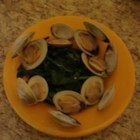 Steamed Clams in Butter and Sake - This recipe is the best for seafood lovers. Clams are steamed with sake and mirin and a bit of green onion in this Japanese-style preparation.