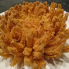 Blooming Onion and Dipping Sauce - This batter-fried onion and a spicy dipping sauce will get your party going any day!