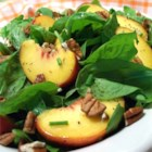 Spinach Salad with Peaches and Pecans - Crisp spinach, succulent peaches and aromatic pecans pair with poppyseed dressing in this terrific salad.