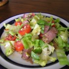 Steak Salad - Seared sirloin and a light vinaigrette top this crunchy, refreshing salad of romaine with tomatoes, peppers, red onion, green olives and blue cheese.