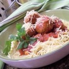 Chicken Meatballs and Spaghetti - Chicken meatballs are simmered in a homemade tomato sauce and served with spaghetti noodles.
