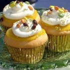 Maharani Cupcakes - These coconut cupcakes with curry lemon curd and a sweet basil cream topping are regal enough for a queen! They take time to create, but the end result is worth it.
