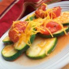 'Calabacitas Guisada' (Stewed Mexican Zucchini) - This classic comfort food consists of Mexican zucchini rounds simmered in stewed tomatoes, onions, and garlic then loaded with mild cheddar cheese.