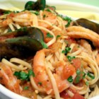 Seafood Marinara Pasta - Mussels and shrimp are simmered in a fragrant tomato sauce and served over pasta.