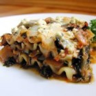 Artichoke Spinach Lasagna - This is a fabulous lasagna made with an artichoke and spinach mixture which has been cooked with vegetable broth, onions and garlic.  The mixture is layered with lasagna noodles, pasta sauce, mozzarella cheese, and topped with crumbled feta.