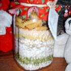 Country Soup in a Jar - Six beans, grains and pastas are layered to a pretty effect in a glass jar with seasonings and bouillon granules in this winning idea for a hostess gift.