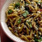 Quick Greek Pasta Salad with Steak - This rich, delicious pasta dish combines succulent rib-eye steak pieces with whole wheat penne pasta in a sun-dried tomato and spinach sauce.