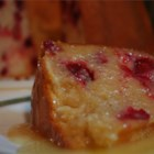 Ultimate Cranberry Pudding Cake - An absolutely delicious cranberry Bundt cake. The hot butter sauce is to die for. Great for the holidays!