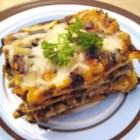 Simple Spinach Lasagna - Spinach with three types of cheese and herbs, layered with red sauce and noodles.