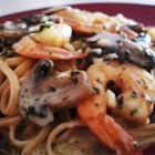 Shrimp and Mushroom Linguini with Creamy Cheese Herb Sauce - Cooked shrimp and sliced fresh mushrooms are bathed in sauteed garlic, cream cheese, fresh parsley and a dash of basil. Toss with hot linguini and serve as an elegant appetizer or main dish.