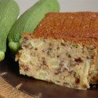 Zucchini Pineapple Bread II - A touch of the Hawaiian Islands highlights this sweet zucchini-nut bread.  No spices are called for;  the rich sweetness of pineapple and raisins provide ample interest.
