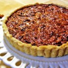Pecan Pie III - The proportions of sugar, corn syrup, eggs, vanilla, and pecans are perfectly balanced. This is the quintessential pecan pie, made even more wonderful with a dollop of whipped cream.