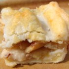 Danish Pastry Apple Bars II - Apples spiced with cinnamon are baked with a crunchy cornflake layer in pastry shell, topped with a sweet almond glaze and cut into bars -- like apple pie you can eat with your hands.