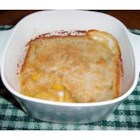 Southern Peach Cobbler - The crust rises to the top in this easy cobbler made with canned peaches and a simple batter of self rising flour and milk.