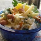Aloha Coleslaw - Colorful and sweet, this unusual cabbage coleslaw boasts bits of pineapple and carrot in a creamy base.