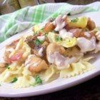 Amazing Italian Lemon Butter Chicken - This recipe introduced to me by an Italian woman combines thin strips of chicken breast in a lemon butter sauce with bacon, mushrooms, artichoke hearts, and capers; served over bowtie pasta.