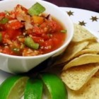 Garden Tomato Salsa - A fresh, easy way to use up your garden tomatoes. Mix and match different varieties of tomatoes for this salsa. It will keep well for several days in the refrigerator.