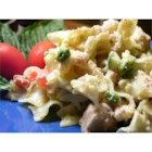 Cheesy Tuna Noodle Casserole - This home-style favorite is full of tuna, onion, green and red bell pepper, and noodles in a mild Cheddar cheese sauce. It's topped with seasoned breadcrumbs and baked until crisp and golden brown.