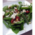 Feta and Slow-Roasted Tomato Salad with French Green Beans - Slow-roasted cherry tomatoes bring their concentrated, sweet flavor to a salad made with arugula and green beans, and topped with toasted pine nuts and feta cheese.