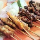 Singapore Satay - Tender chicken strips are marinated in a delicious but simple Asian mixture, made with lemon grass, then threaded onto skewers and grilled over high heat.