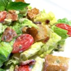 B.L.T. Salad with Basil Mayo Dressing - Crispy romaine lettuce, juicy cherry tomatoes, crunchy-fried bacon and homemade croutons are tossed with a creamy, tangy, fresh basil infused dressing in this satisfying salad!