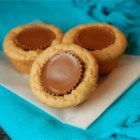 Peanut Butter Cup Cookies - Peanut butter cups wrapped in a peanut butter cookie for the most peanut buttery of treats.