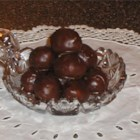Bonbons - A sweet mixture of coconut, walnuts, sugar, margarine and condensed milk are rolled into little balls and dipped in chocolate to make these decadent frozen treats.