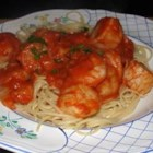 Shrimp, Clams, and Scallops Pasta - Seafood combined with a savory red sauce over pasta will tease your senses! I serve mine with fresh garlic bread and a green garden salad. YUM!