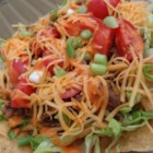 Taco Salad II - Envision a thick taco brimming with chopped tomatoes, ground beef, lettuce, and lots of shredded cheese. You'll have a pretty good idea of what this nifty salad will be like. Except this one you top with a Catalina dressing. Refrigerate overnight and enjoy.