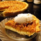 Old Fashioned Paradise Pumpkin Pie - This pie 's three layers are sensational: The bottom is a creamy cheesecake layer, the middle is a sweet and spicy pumpkin layer, and the top is a butter pecan streusel that melts and mingles with the pumpkin layer as it bakes.