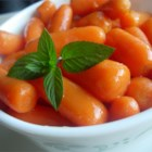 Orange Glazed Carrots - Baby carrots are simmered in a sweet sauce of orange juice, brown sugar and butter.