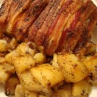Bacon-Roasted Chicken with Potatoes - Chicken drumsticks and thighs are wrapped in bacon and baked with baby potatoes and a special seasoning mix.