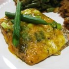 Cheesy Baked Salmon - This is such a simple recipe, and it is so delicious! Salmon is baked with garlic and dill, and topped with Cheddar cheese and green onions.