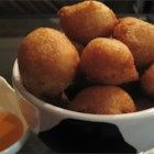 Coconut Puffs - A coconut milk batter spiced with cinnamon and cardamom is deep fried in this unique treats.